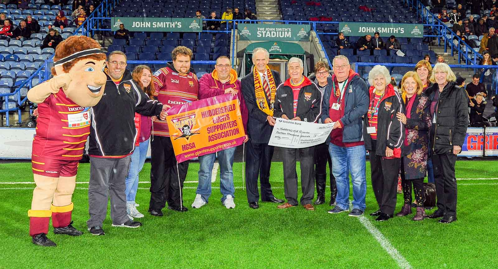 Your committee presenting Ken Davy with a cheque for £14 000, the result of our 2018 efforts. The money goes towards the development of youth rugby.
